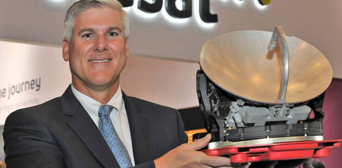 James Person holds Viasat's Ka-band antenna which brings high-speed broadband to mid- and super-midsize jets.
