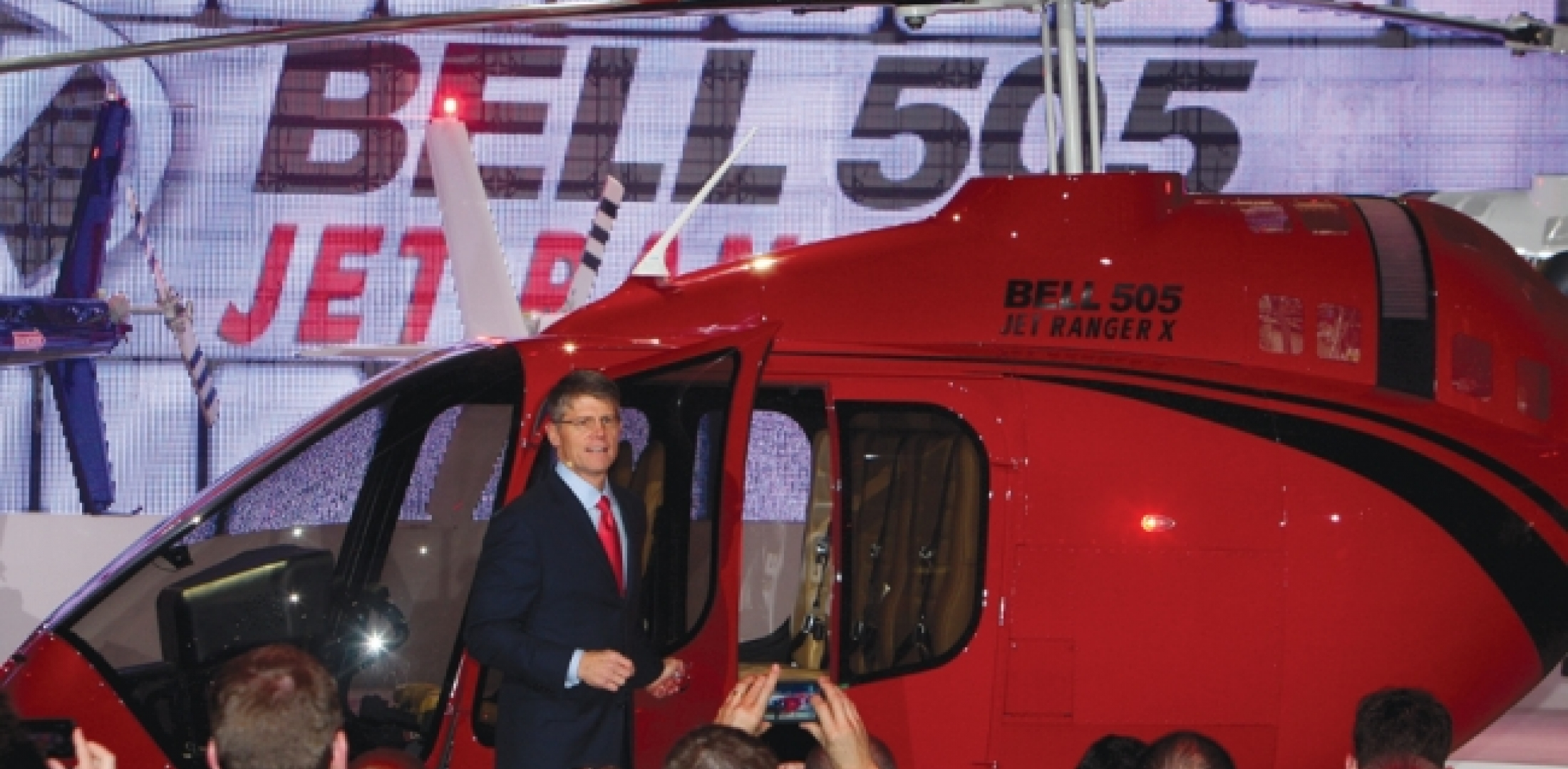 In a choreographed display of lights and music, Bell Helicopter unveiled not one but three full-scale mockups of what the company had been calling its short light single helicopter and now calls the Bell 505 Jet Ranger X. Bell CEO John Garrison  said that the new model will be priced at about $1 million to make it price competitive with the Robinson Helicopter R66.  Photo by Barry Ambrose.