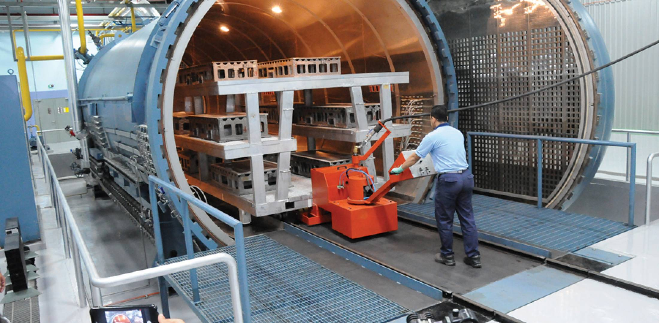 A worker loads aircraft parts into a new autoclave at the expanded Aerospace Composites Malaysia facility, jointly owned by Boeing and Hexcel. The factory is to be expanded by 40 percent to accommodate increased production by Boeing Commercial Airplanes.