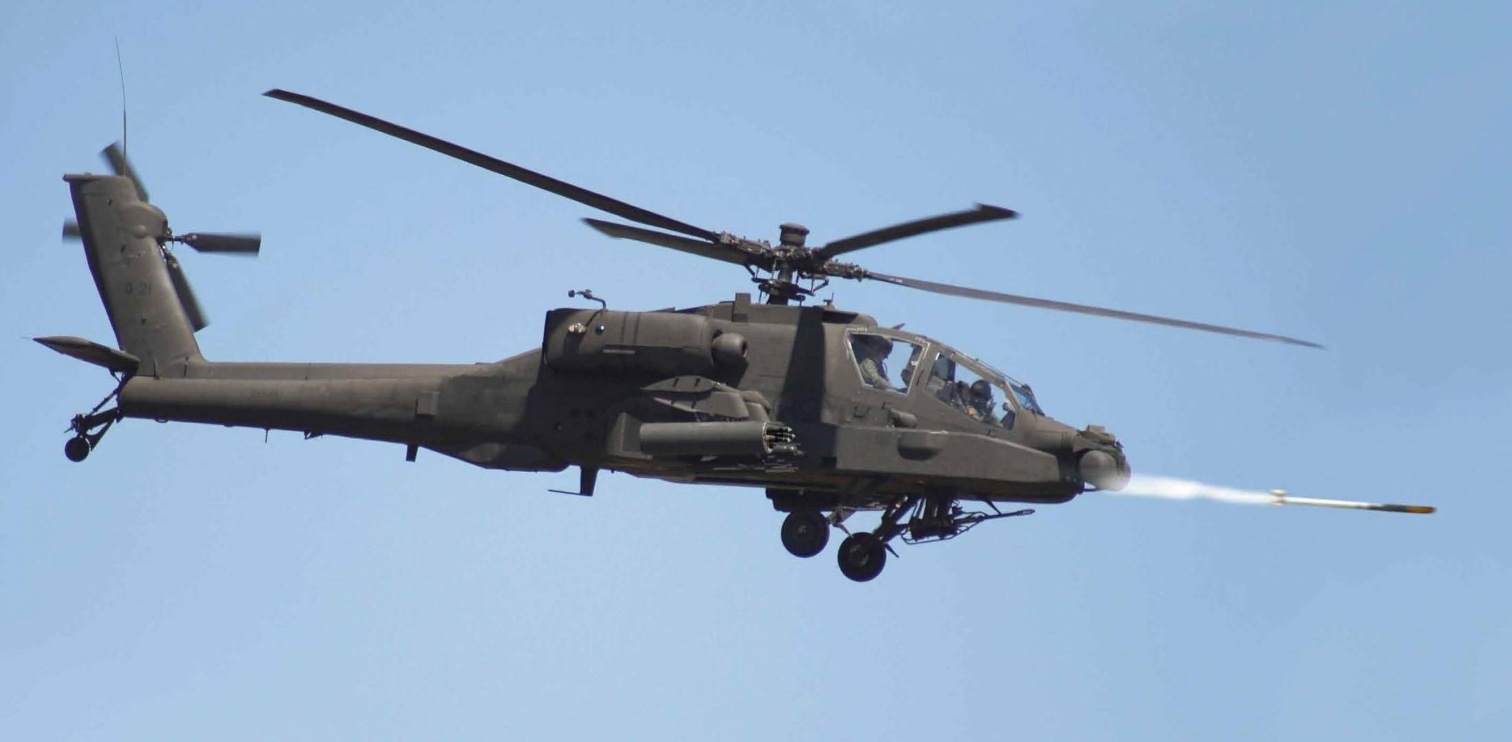 Apache fires a laser-guided rocket