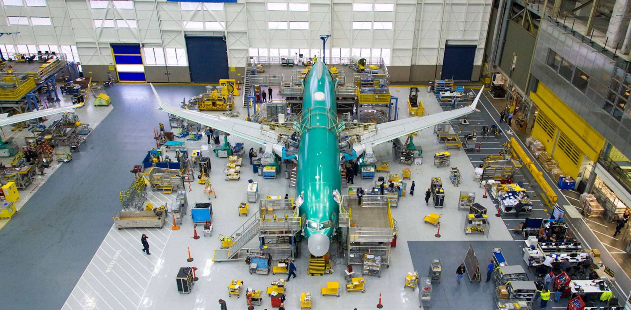 airplane in hangar being worked on