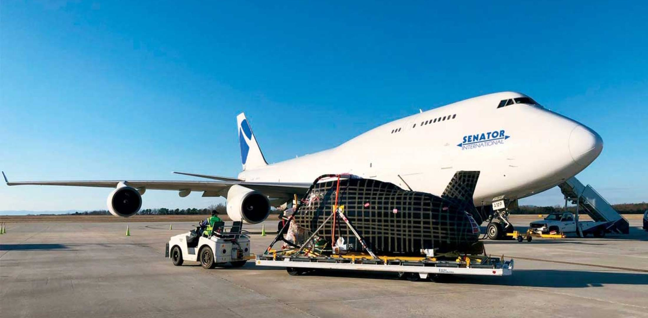 helicopter being loaded on to 747
