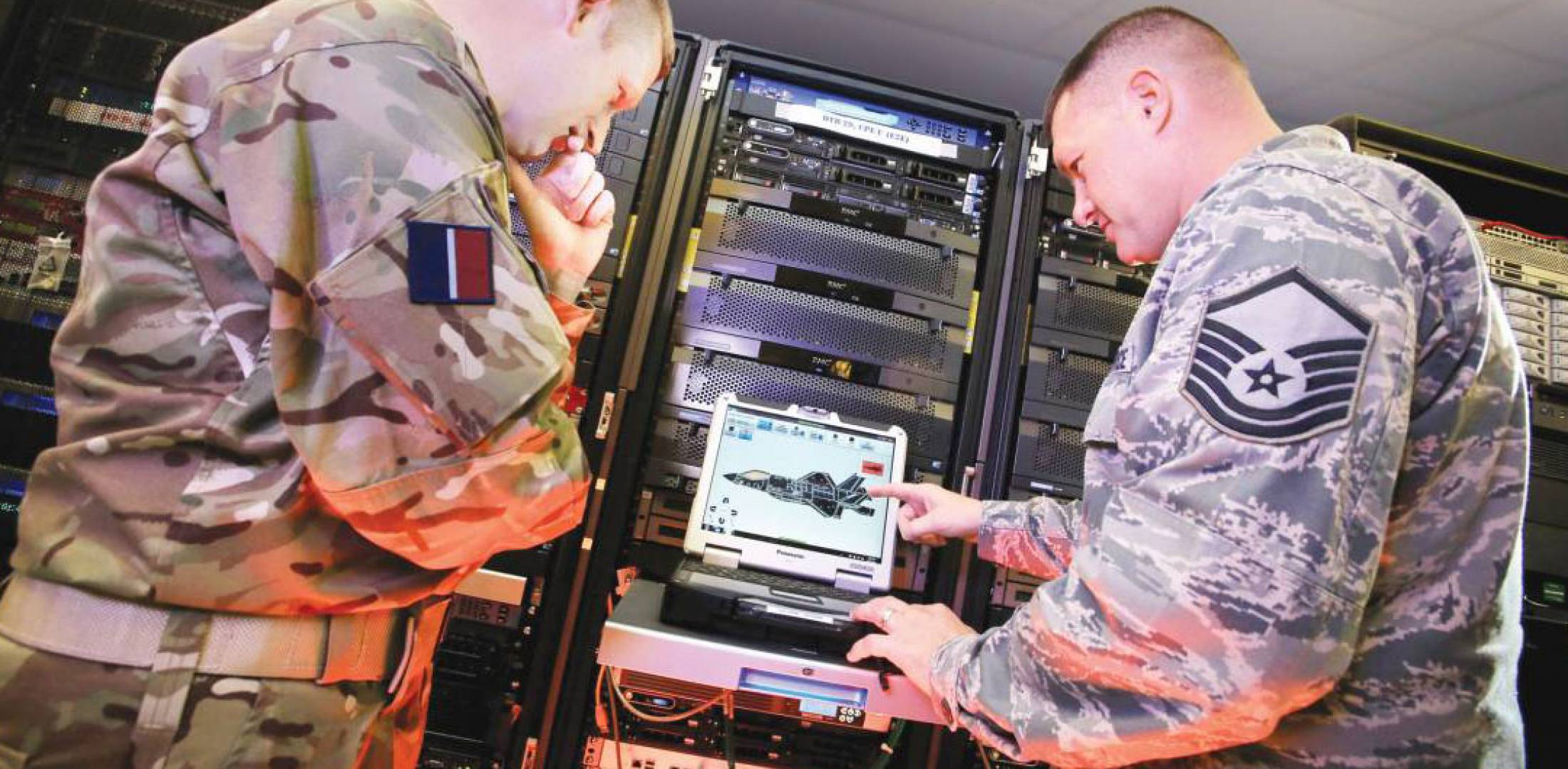 RAF and USAF servicemen review F-35maintenance data.