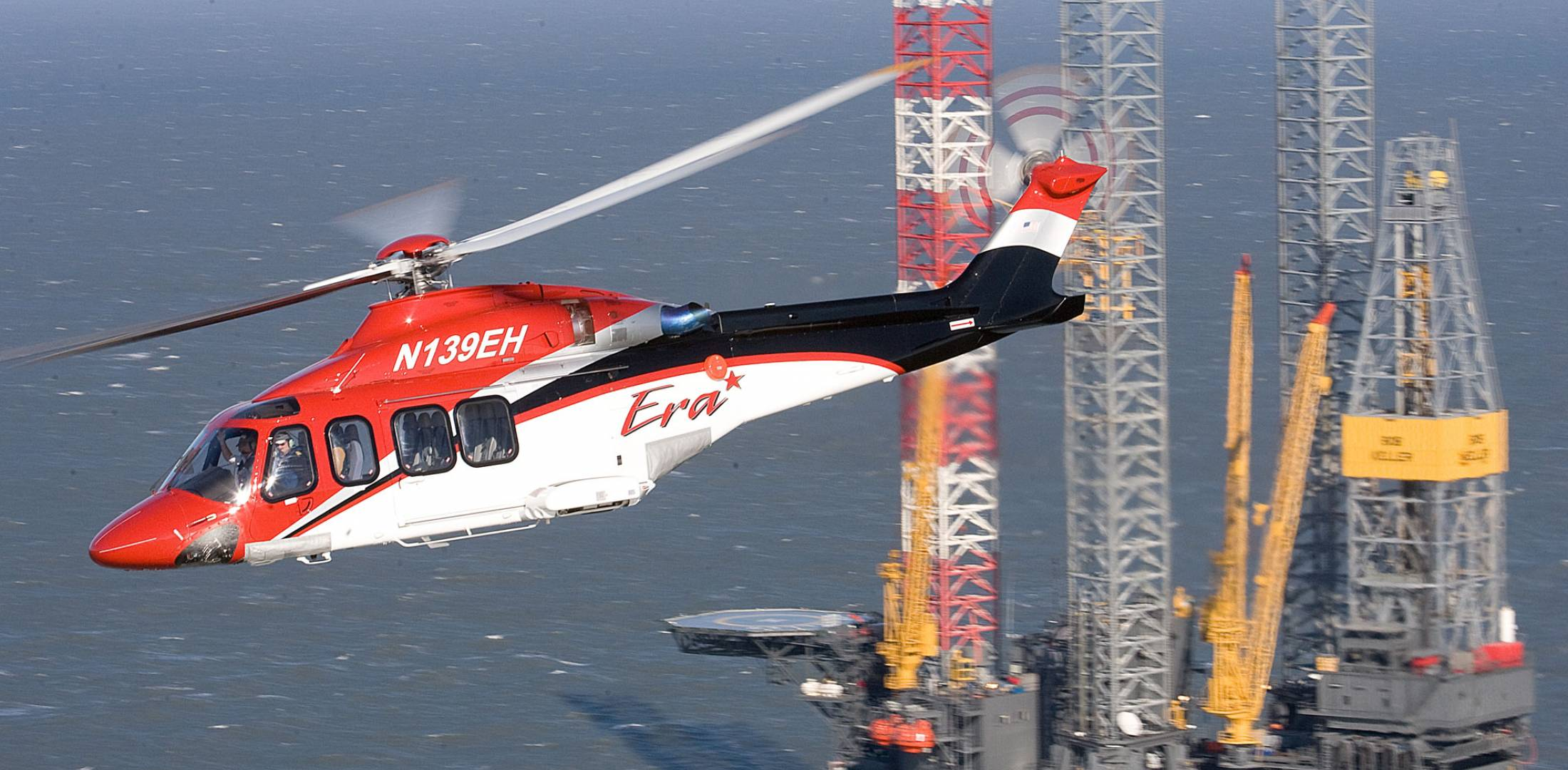 AW139 flying by oil rig
