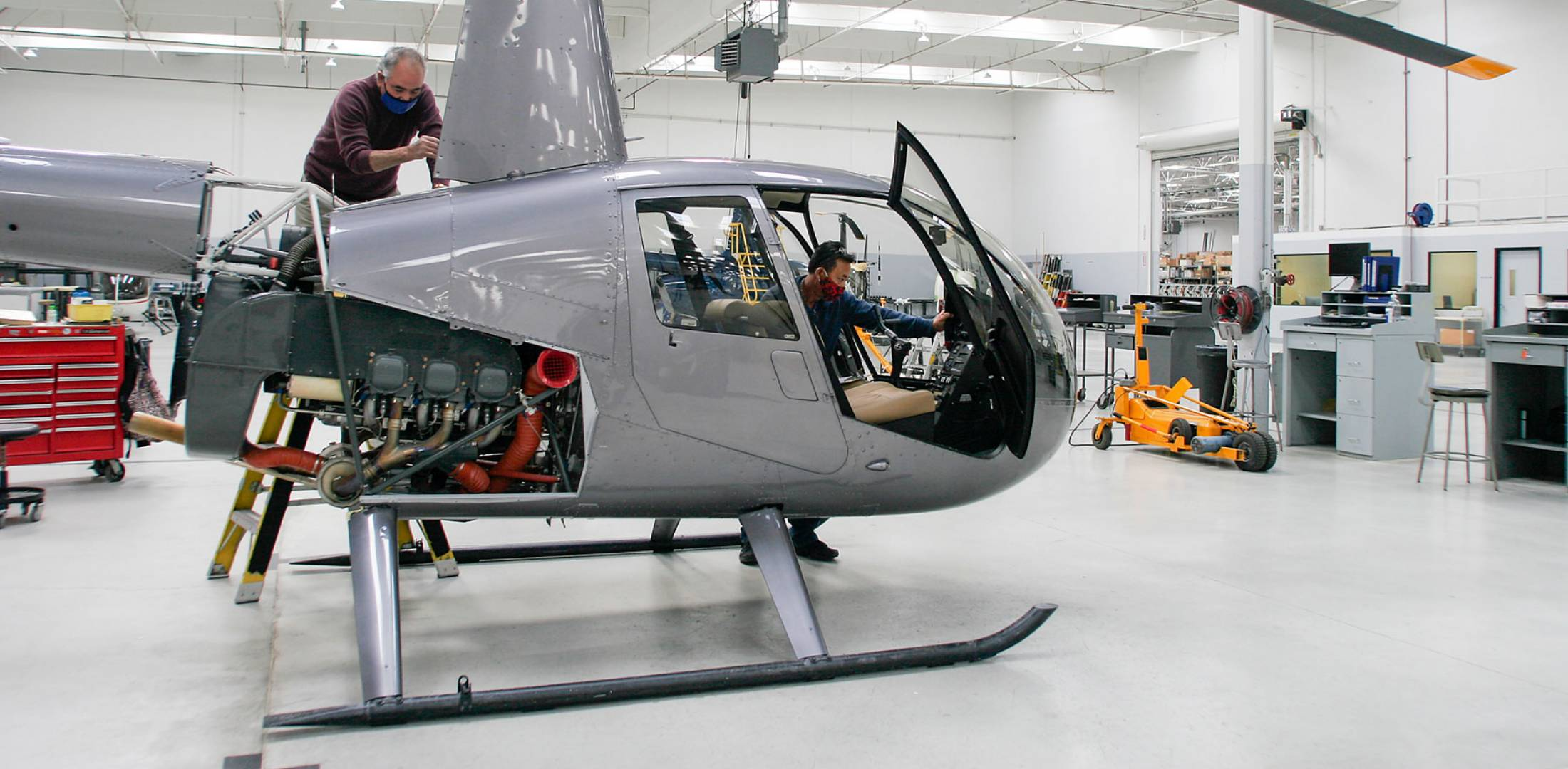 Robinson Helicopters workers in masks on production line