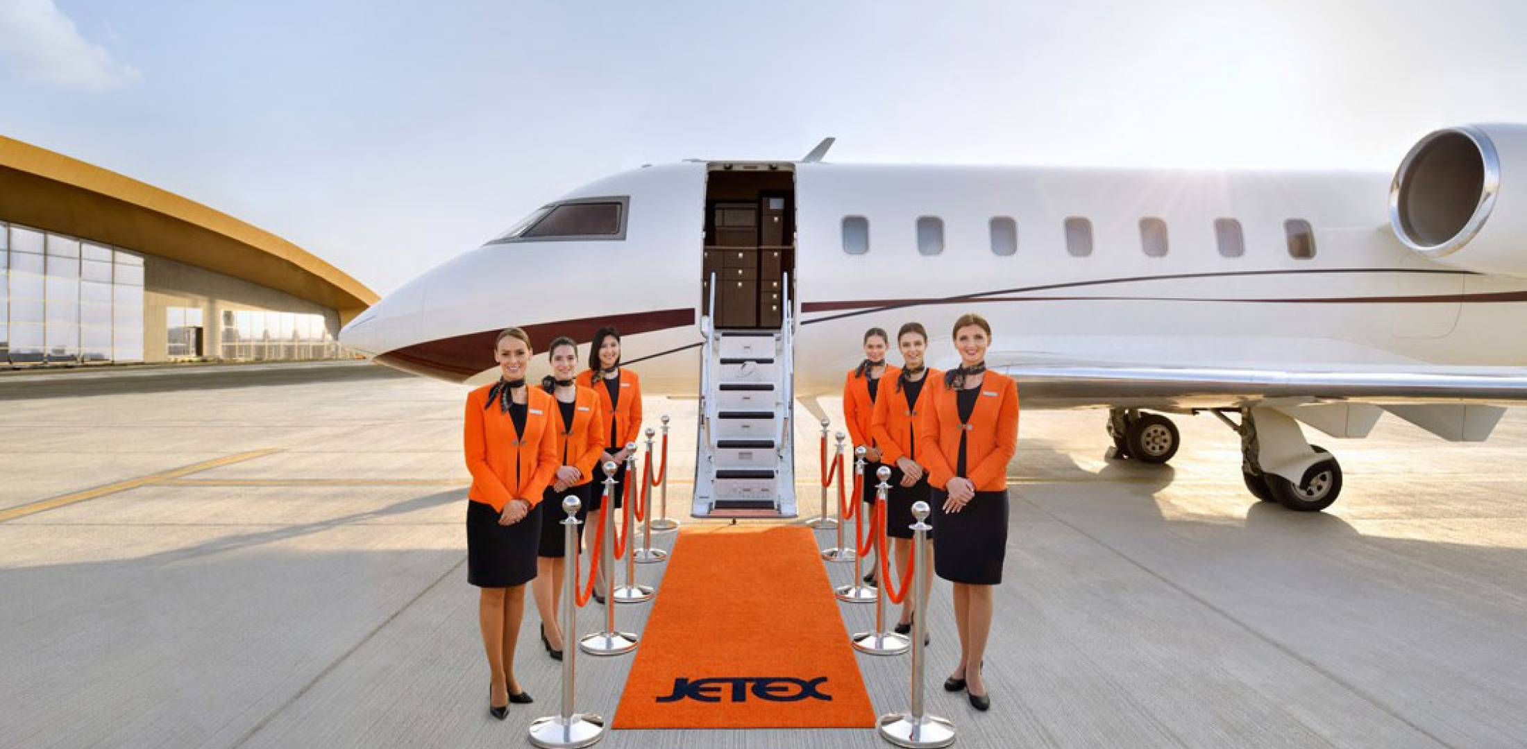 Jetex staff lined up by private jet