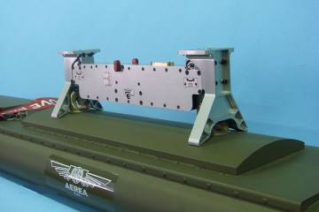The new Ultralight Release Unit has been developed by Italy's Aerea to carry and release weapons for armed UAVs.