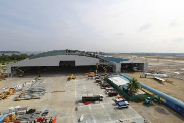 Jet Aviation's expanded Seletar hangar triples the size of the original structure at right.