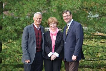 COO Randy Padfield and production director Mary Mahoney, who are retiring this month, with current editor-in-chief Charles Alcock.