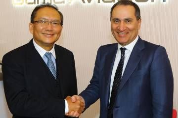 Simon To (l) , managing director of Hutchison Whampoa (China) and Marwan Khalek, CEO of Gama Aviation