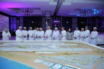 Omani officials in line