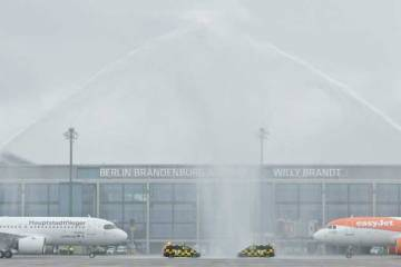 Arriving airliners get water spray salute as BER opens