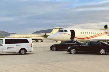 Private jet and vehicles on ramp