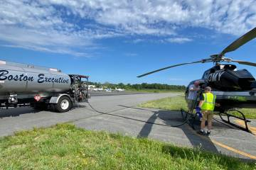 Boston Executive Helicopters Refueller with helicopter