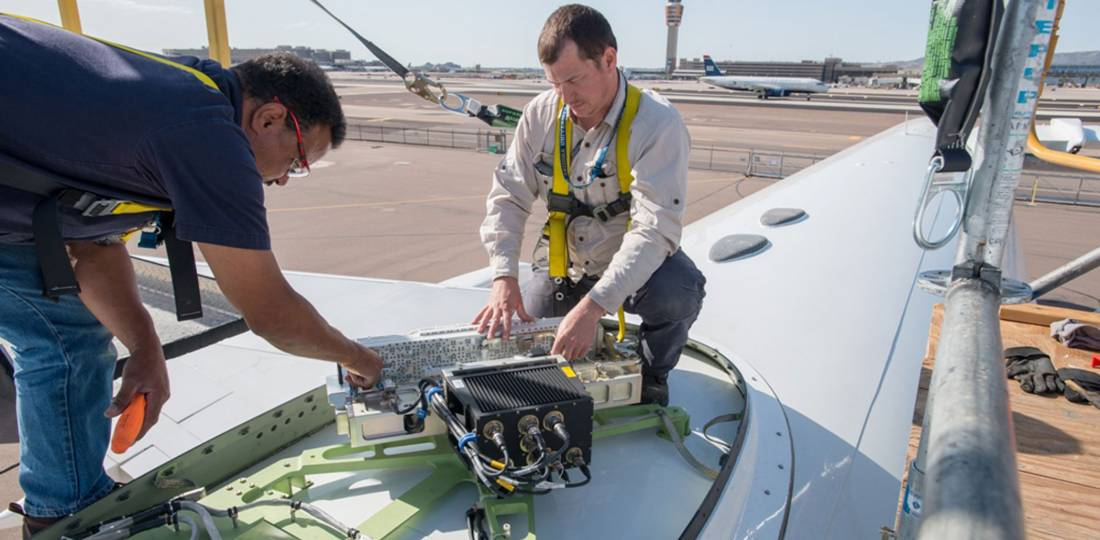 Honeywell workers install JetWave hardware for GX Aviation aboard the company's B757 flying testbed.