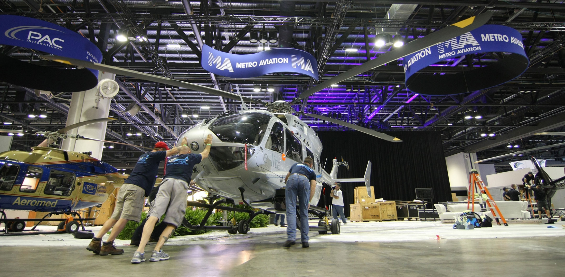"Heli-Expo 2015, Hall Setup: The bright lights of the helicopter industry's biggest show are only part of the story. Before the curtain rises, a cast of thousands labor behind the scenes to breathe life into the ""Greatest show hovering above Earth."" Photos: Mariano Rosales"