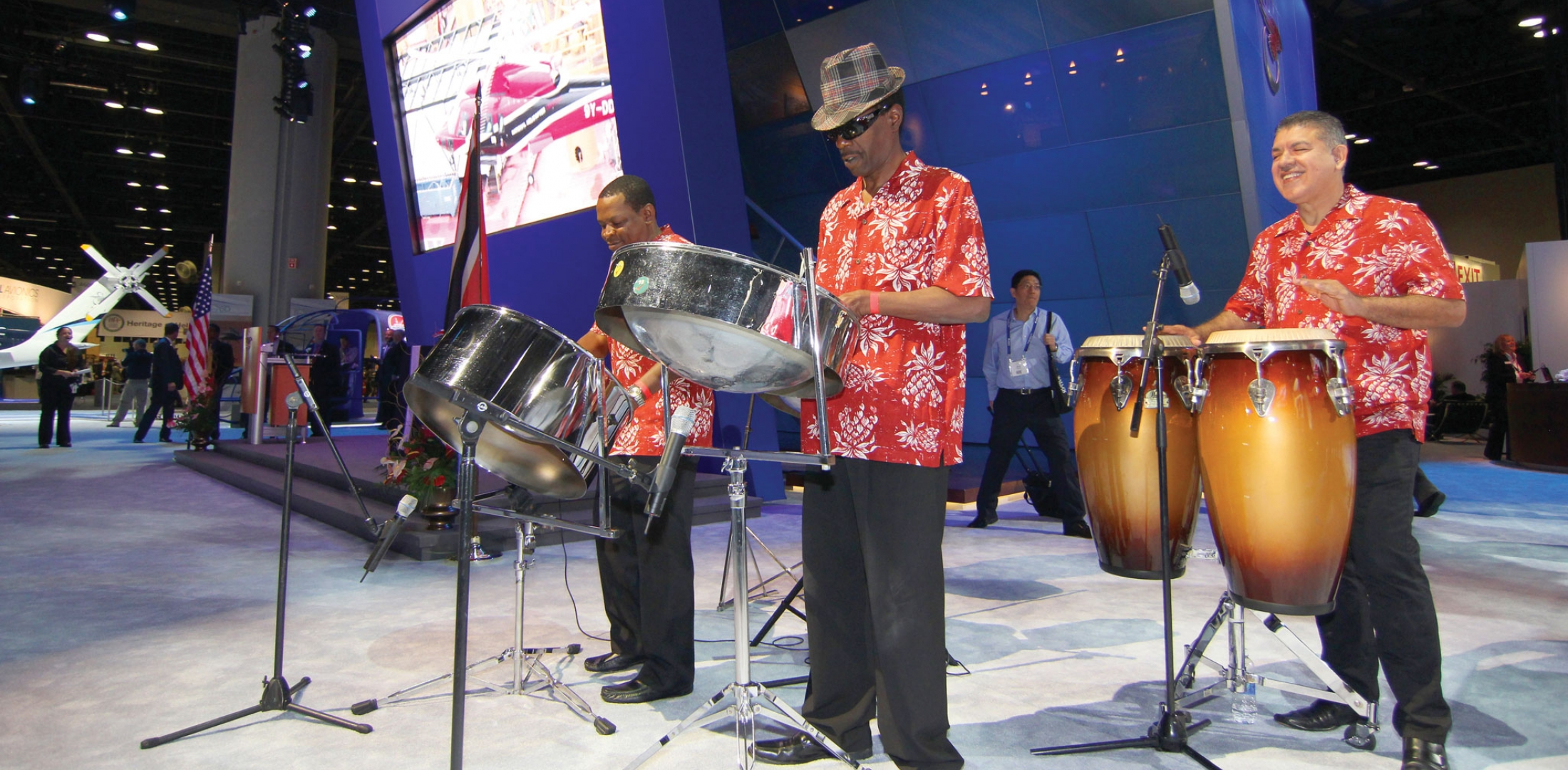 """Even a helicopter show is a """"show"""" and how can you have one without music. The steel-drum band Rhythm Trail performed their percussive sounds, courtesy of Sikorsky Aircraft at its display booth. Photo: Mariano Rosales"""