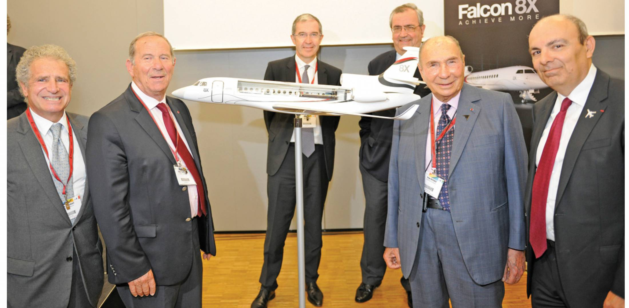 Dassault executives celebrate the launch of their newest model, the Falcon 8X. Left to right: Laurent Dassault, vice chairman and CEO of Groupe Industriel Marcel Dassault; Charles Edelstenne, retired chairman and CEO of Dassault Aviation; Loïk Segalen, COO Dassault Aviation; John Rosanvallon, president and CEO of Dassault Falcon Jet; launch customer Serge Dassault, chairman and CEO Groupe Dassault; and Eric Trappier, Chairman and CEO, Dassault Aviation. (Photo: Mark Wagner)