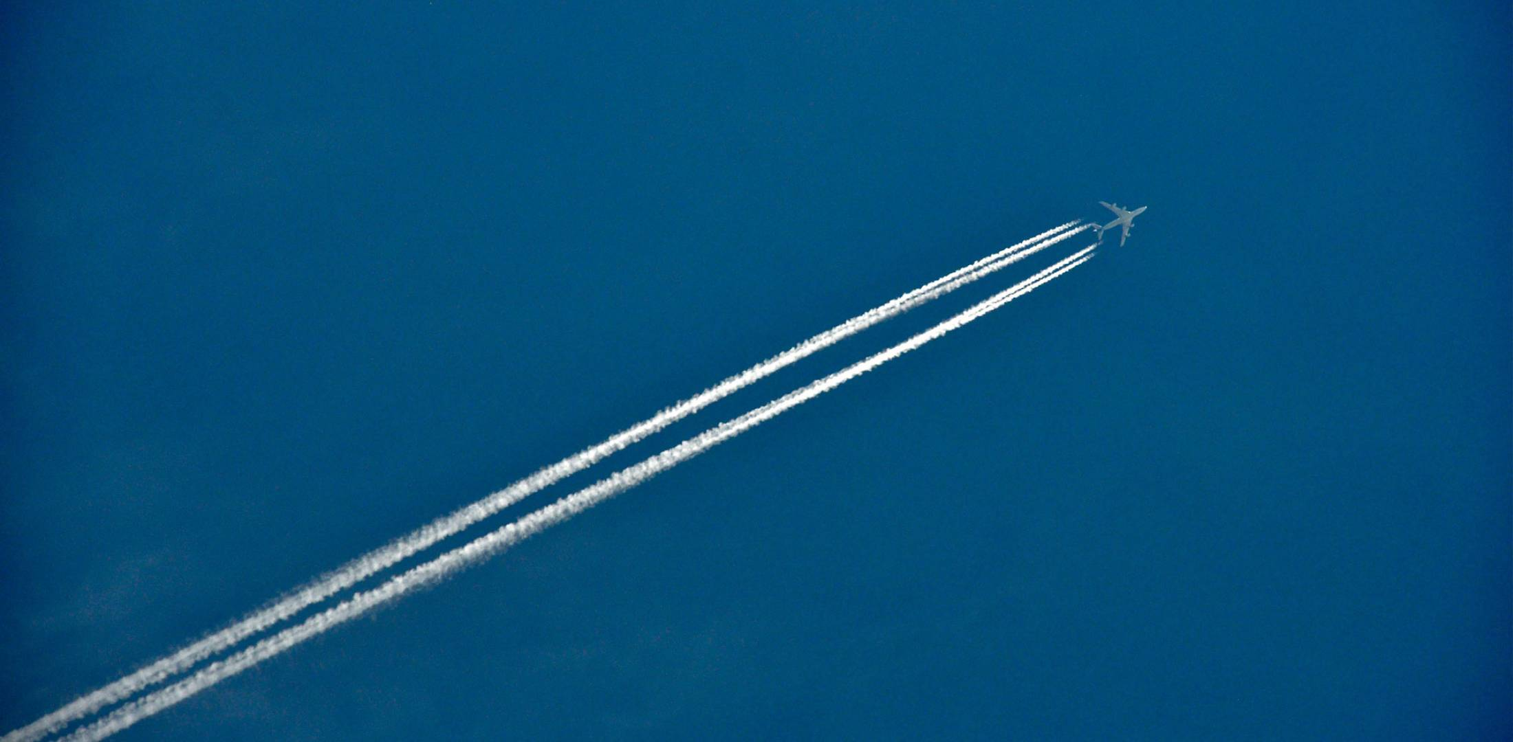 contrails on blue sky