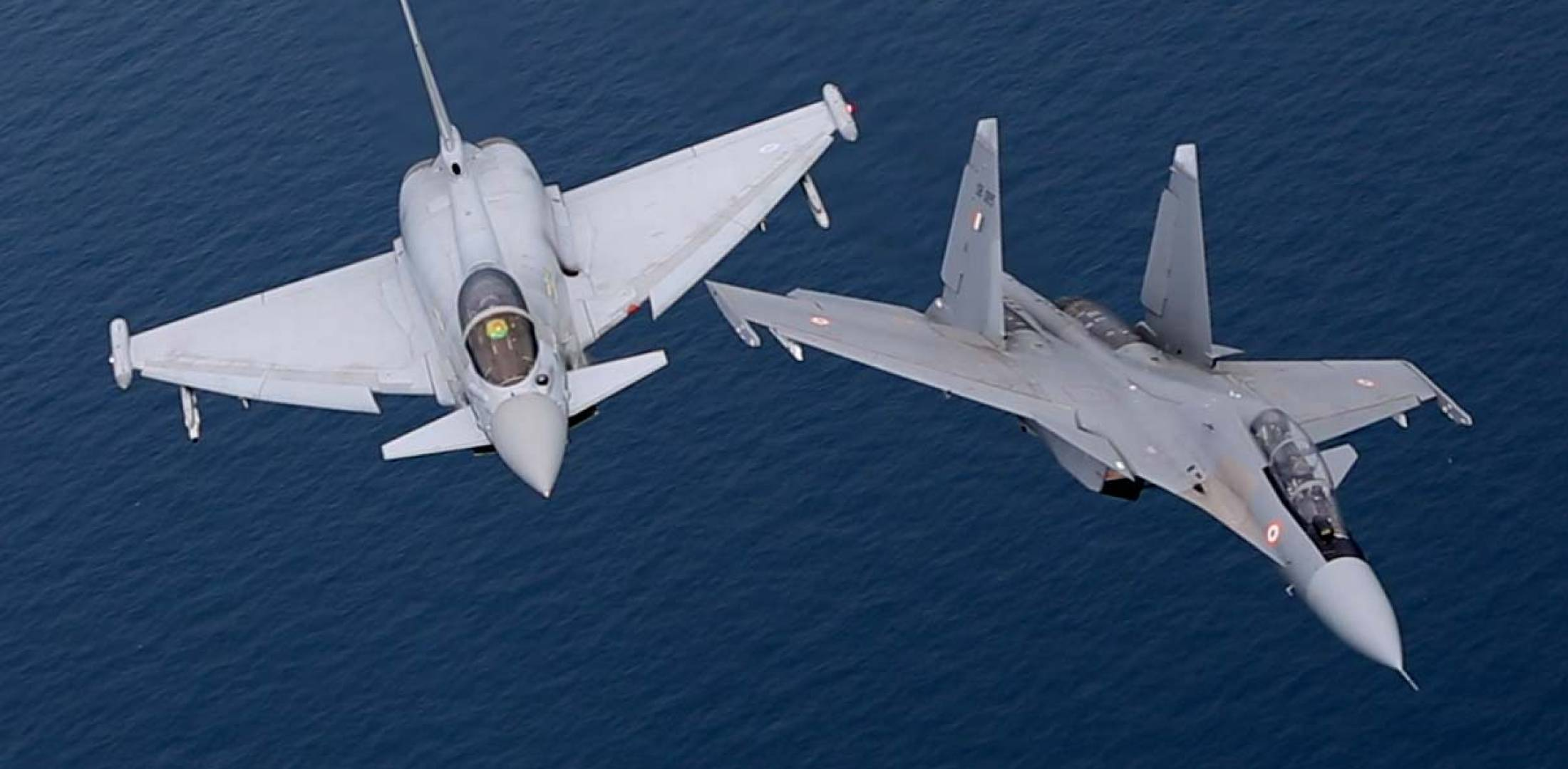 RAF Typhoon, left, and Indian Flanker maneuver during joint exercise. (Photo: MoD Crown Copyright)