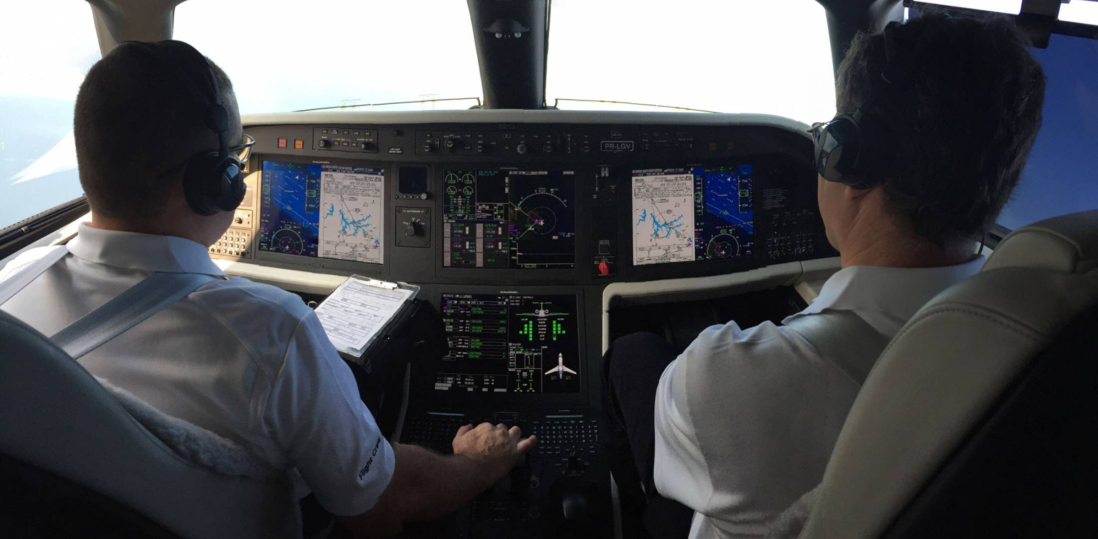 pilots in Legacy 450 cockpit