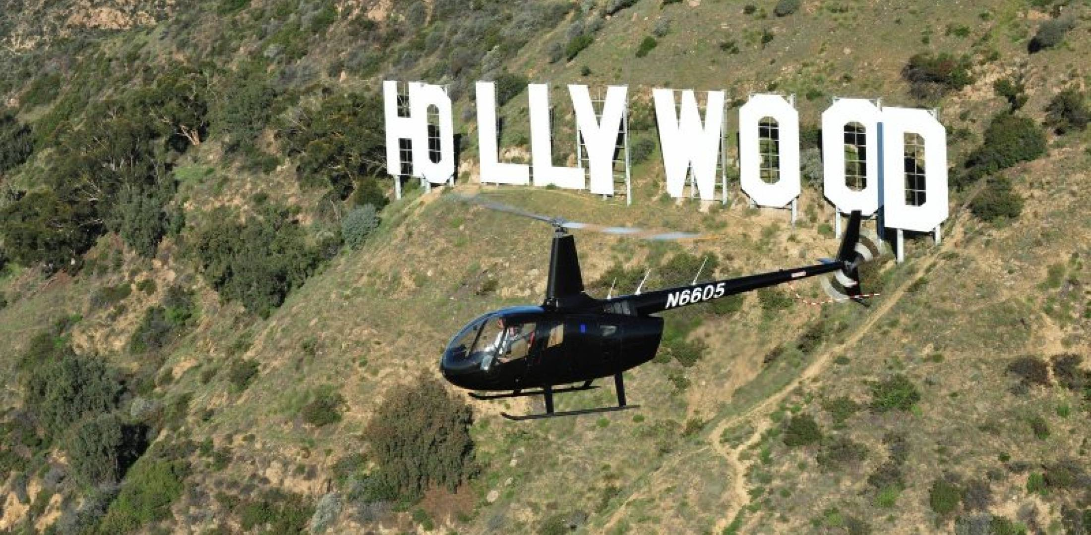 Air tour helicopter over Hollywood sign