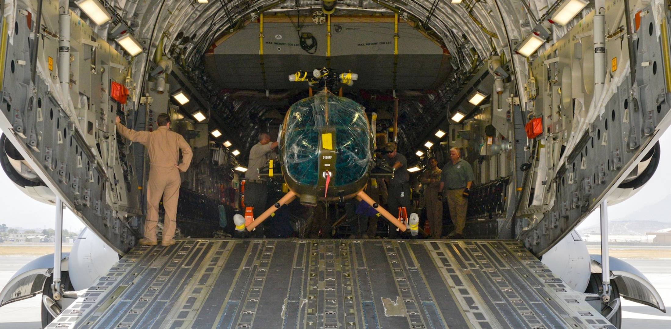 MD 530F is unloaded from C-17 Globemaster III