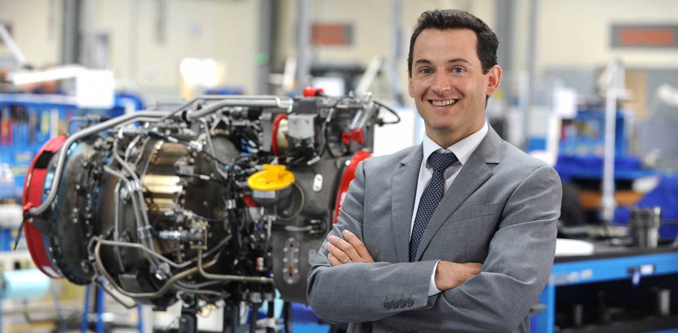 man standing in front of engine