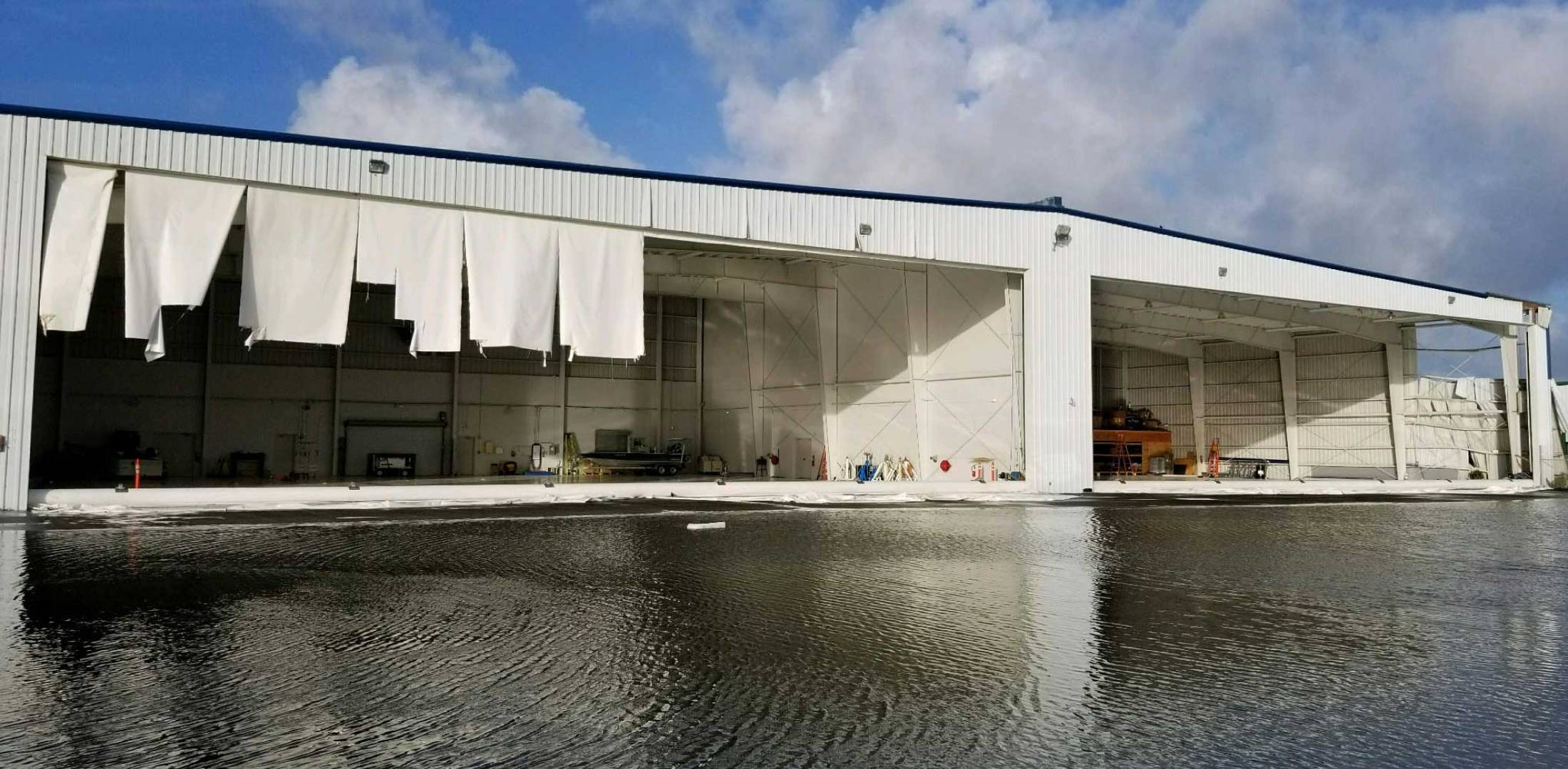 A damaged hangar at Naples Jet Center
