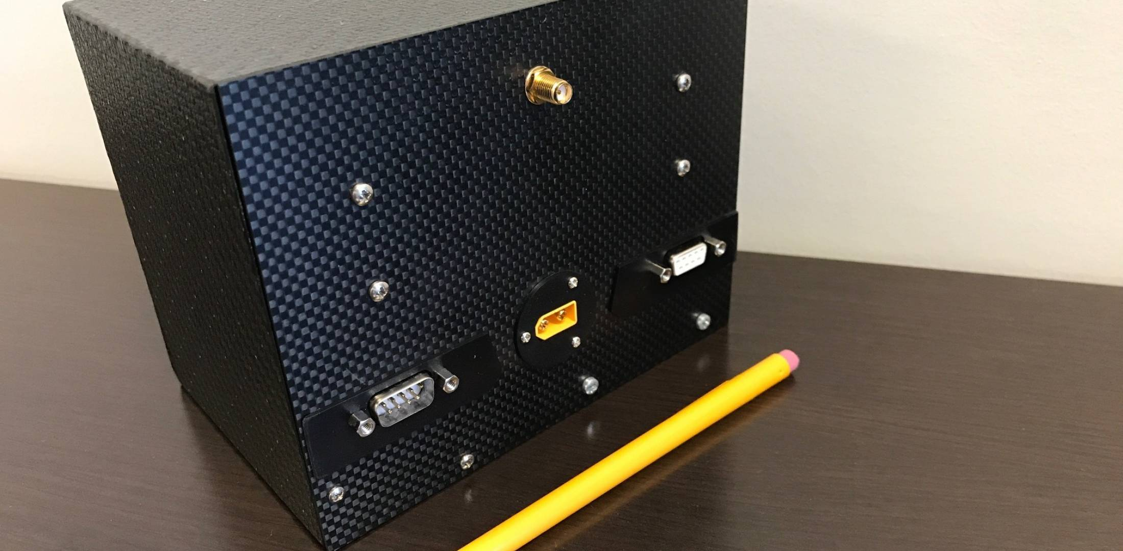 box with pencil to compare size
