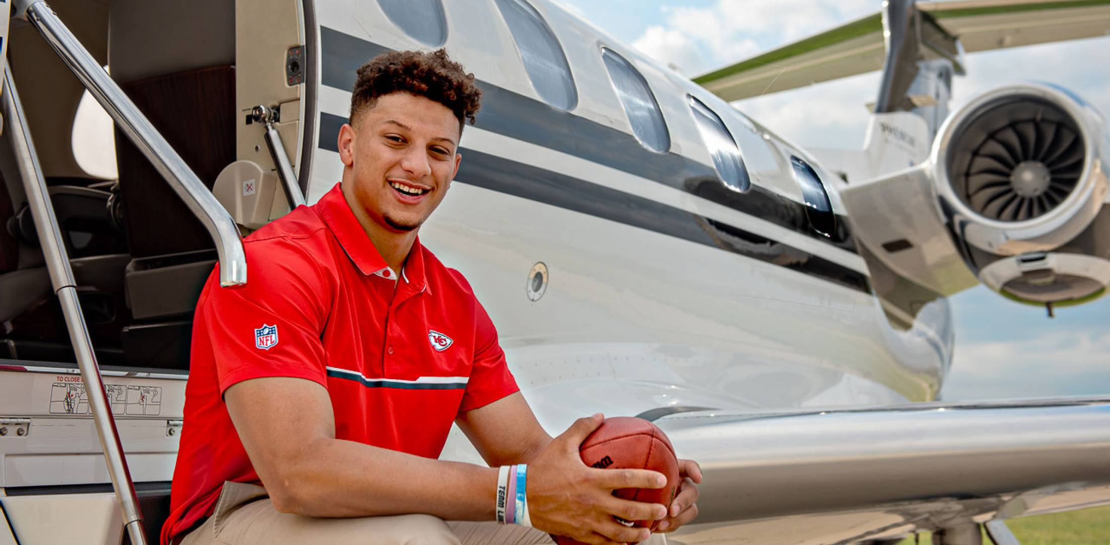Patrick Mahomes with airplane