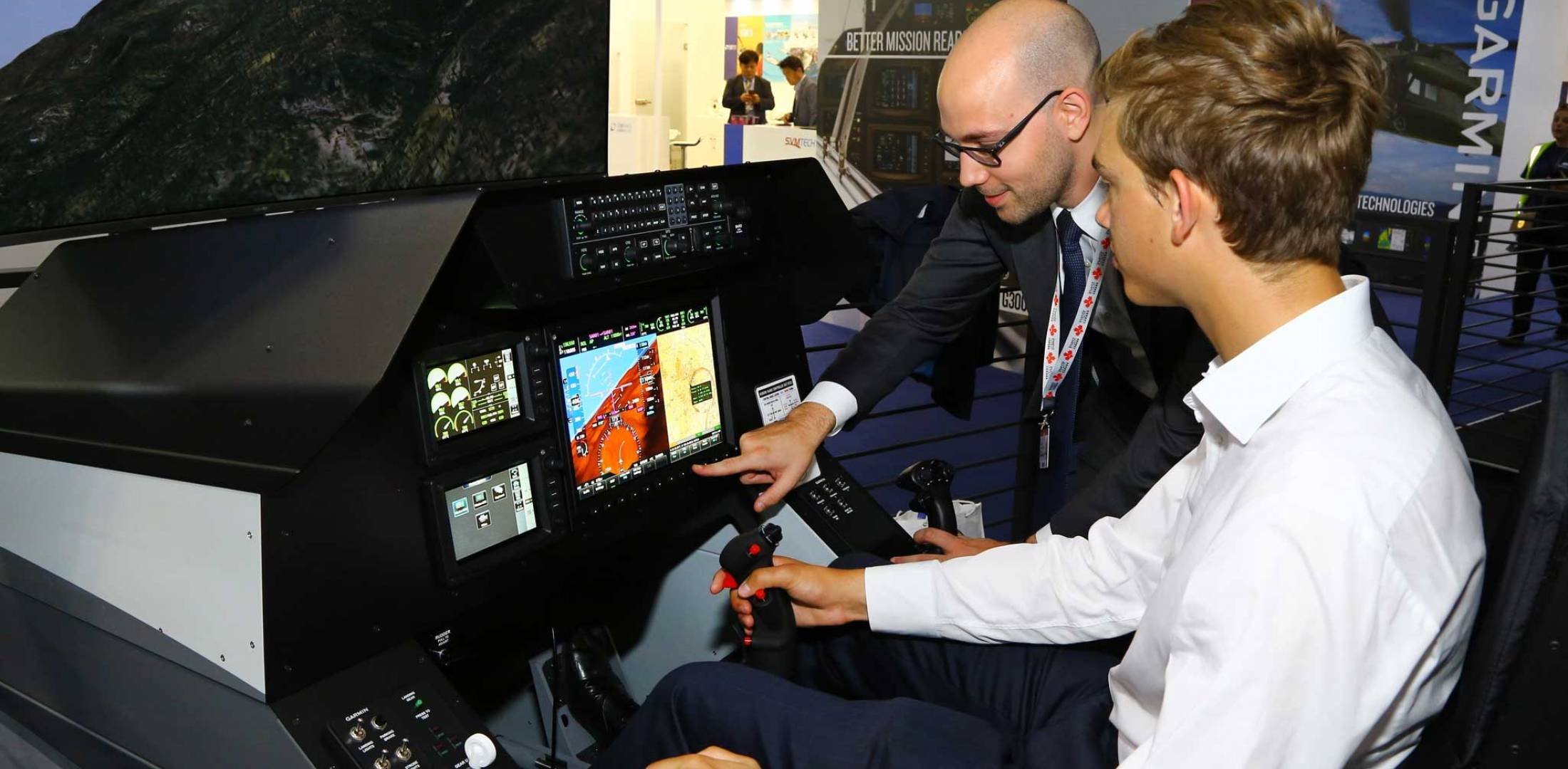 two men in simulator cockpit