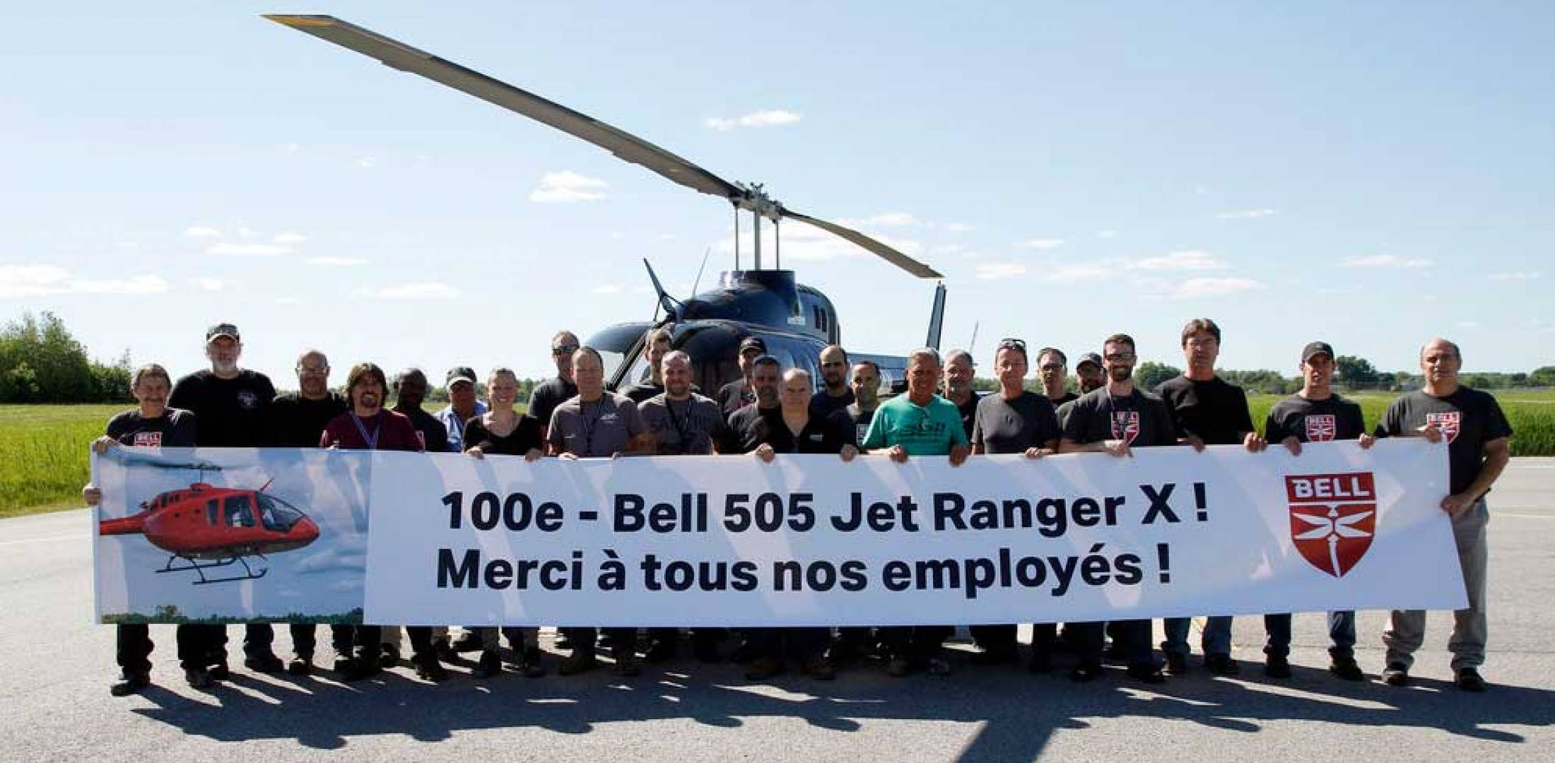 Bell workers celebrating delivery of the 100th Bell 505