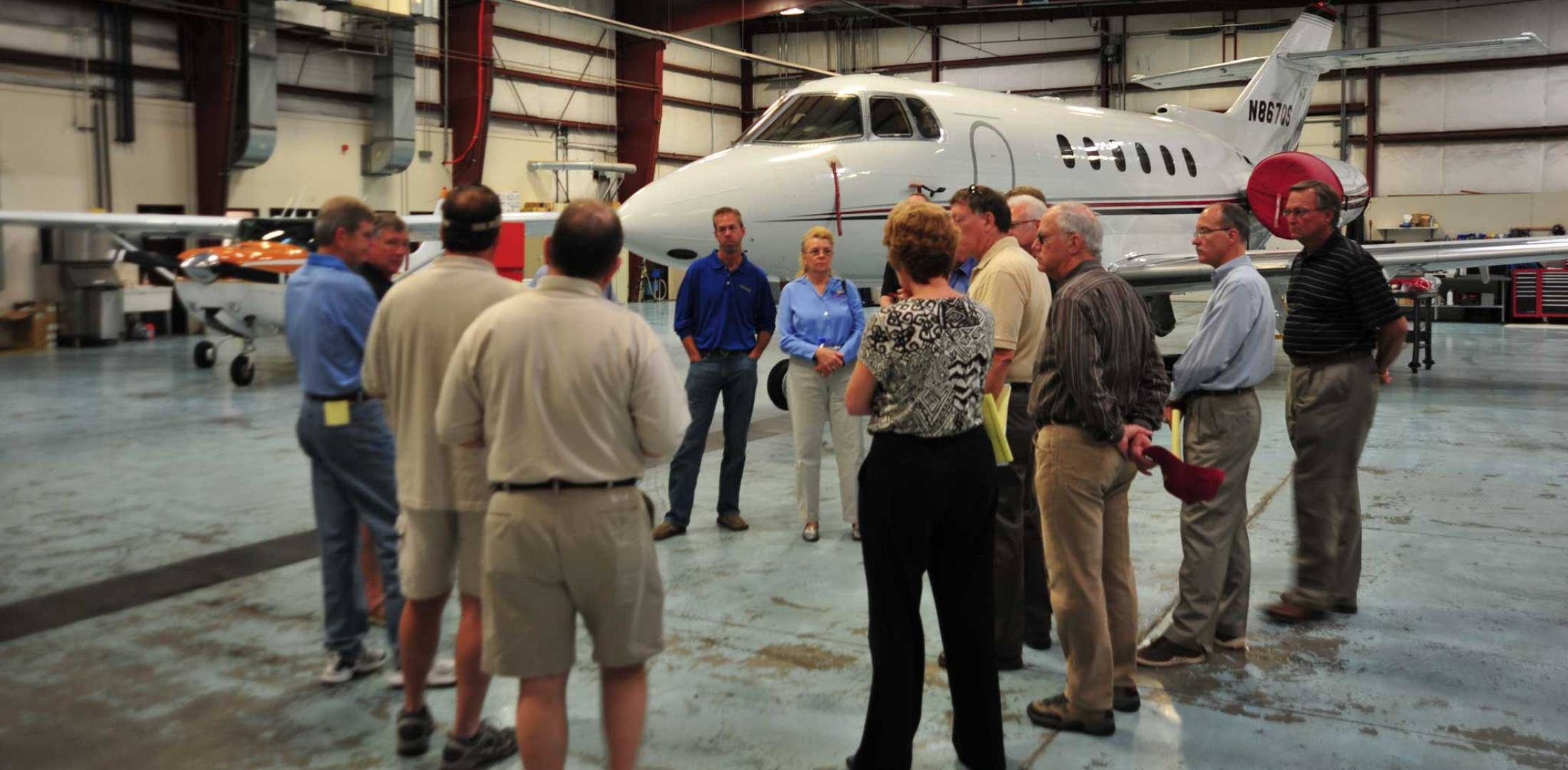 Aviation 20 Group members tour an FBO hangar