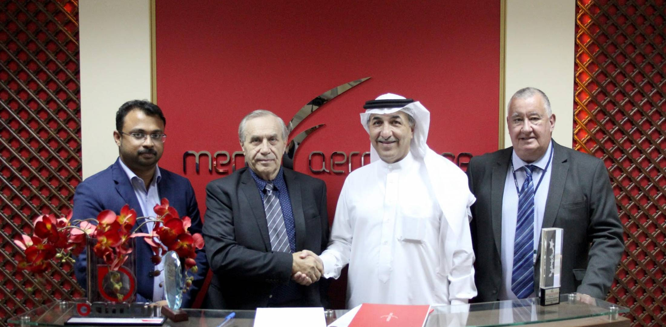 MENA Aerospace's managing director, Mohammed Juman, shakes hands with Alain Auger, Executive Vice President, CSDS (Credit MENA Aerospace)