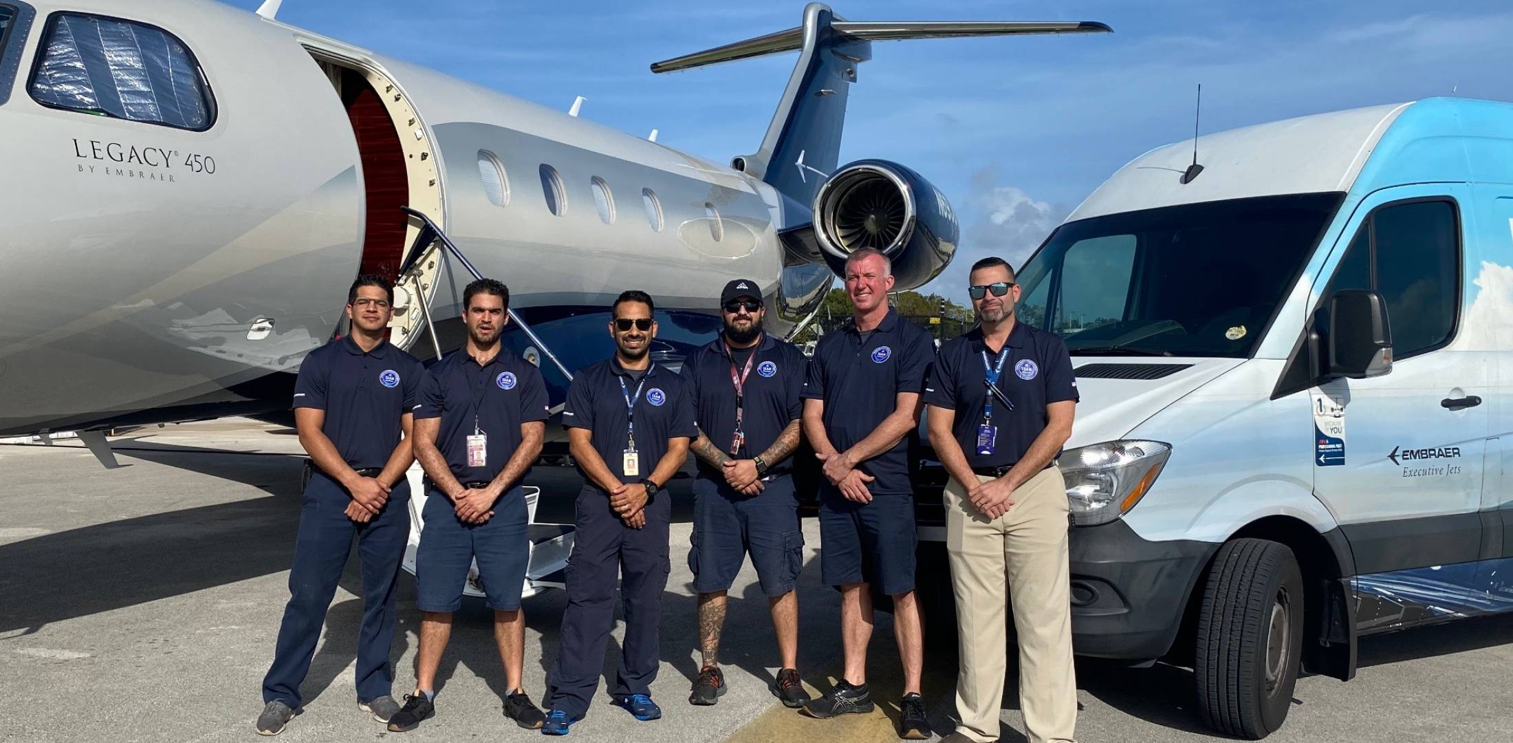 TEAM workers on ramp with plane
