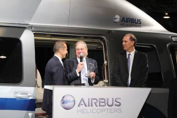 Guillaume Faury, Airbus Helicopters CEO; Crispin Maunder, LCI chairman; and Michael Platt, LCI CEO, celebrate LCI's mammoth Airbus Helicopters order next to the EC175.mockup.  Photo by Barry Ambrose.