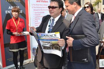 Attendees read ABACE Convention News