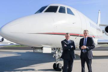 two men in front of a plane