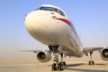 Honeywell brought its Boeing 757 flying test-bed to the static display at MEBAA 2016. The aircraft's special equipment includes a fuselage-mounted pylon, inset, which allows in-flight engine testing with low risk. PHOTO DAVID McINTOSH