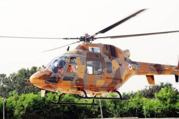 light utility helicopter in flight