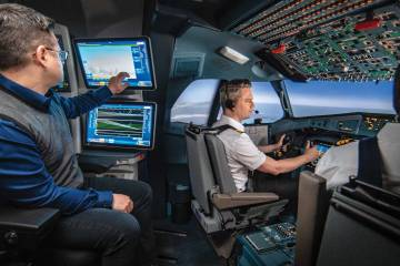 2 men sitting in cockpit