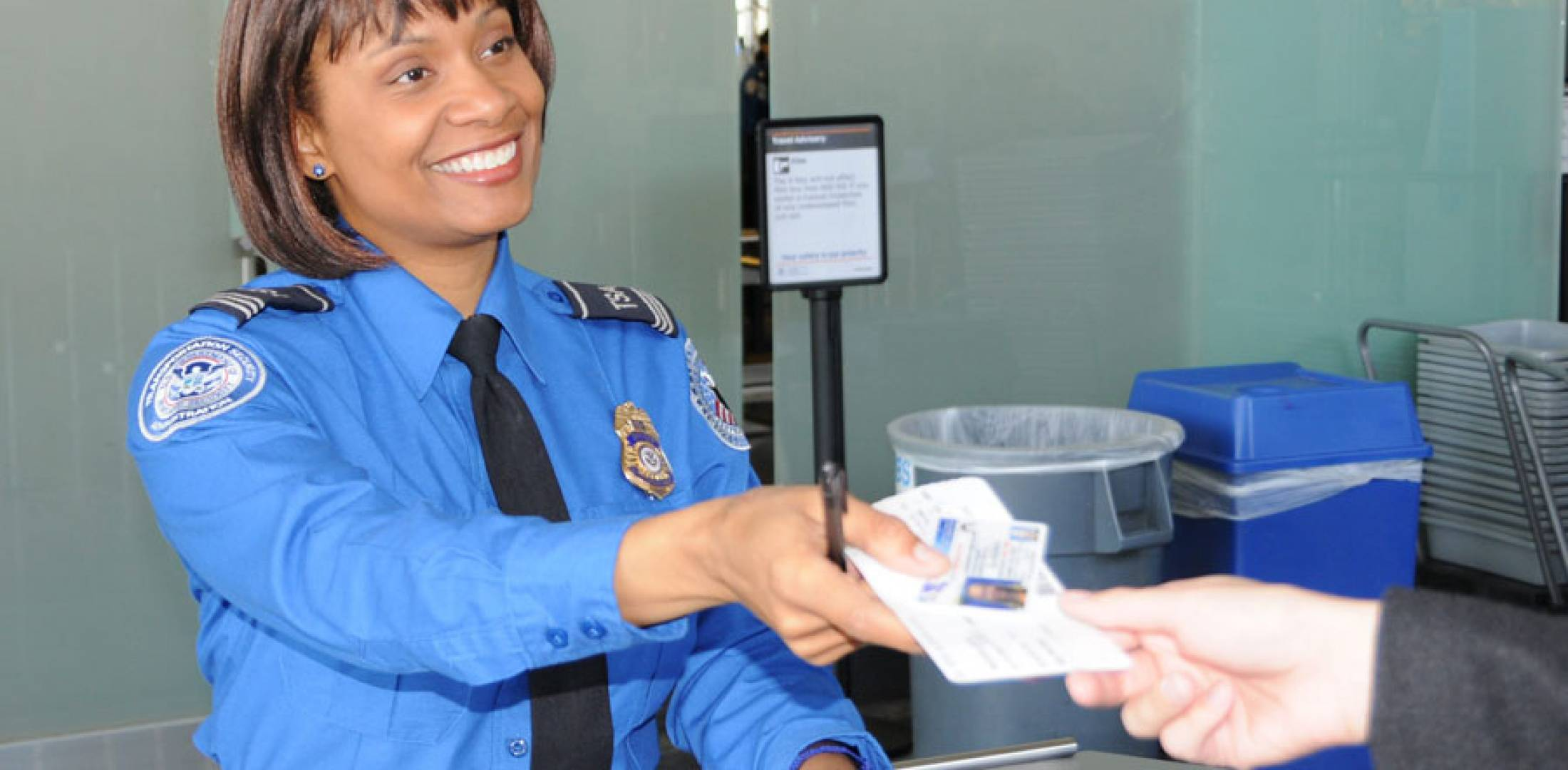 a transportation security officer with the us transportation security administration checks a passengers identification photo tsa