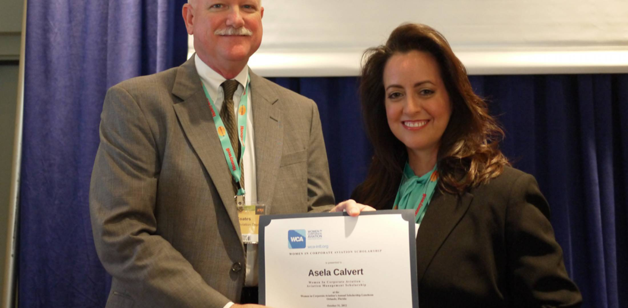 Asela Calvert was awarded the WCA Aviation Management Scholarship by Home Depot chief pilot Joe Coates.