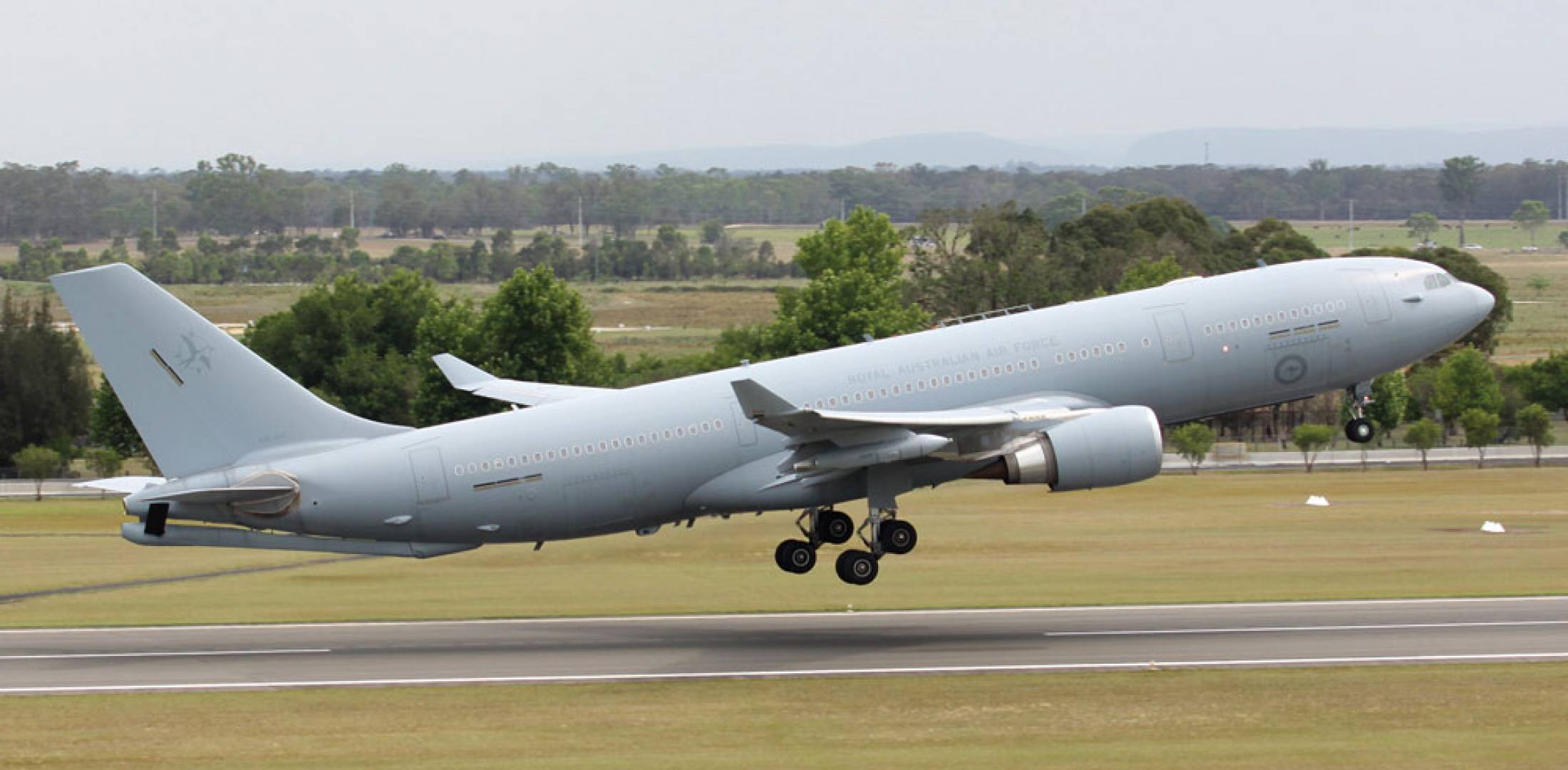"An Australian KC-30A operates from its base at RAAF Amberley. The aircraft is cleared to refuel both ""legacy"" and Super Hornets using its wing pods, but the boom has not yet been approved for use."