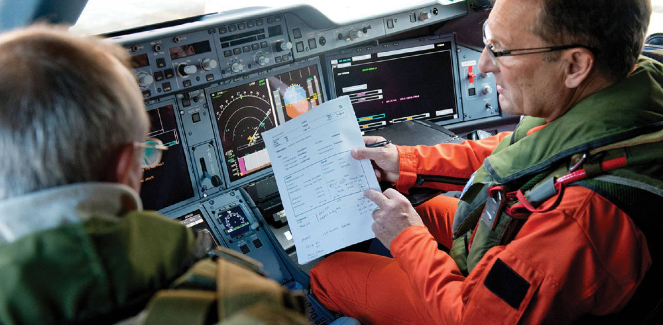 Test pilots review elements of the flight plan before a test hop in the Airbus A350 XWB. The teams of suppliers that contributed to the program are closely watching the trials.