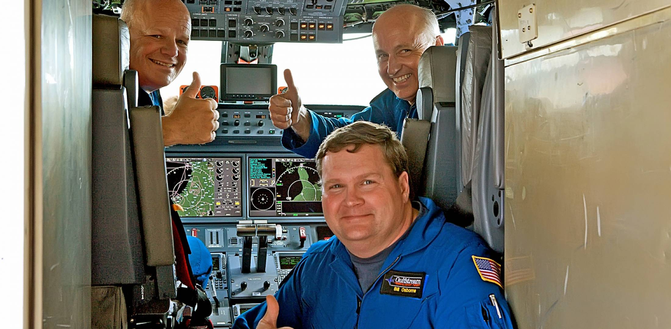 Members of the G650 flight-test crew celebrate achieving Mach 0.995. From lef...