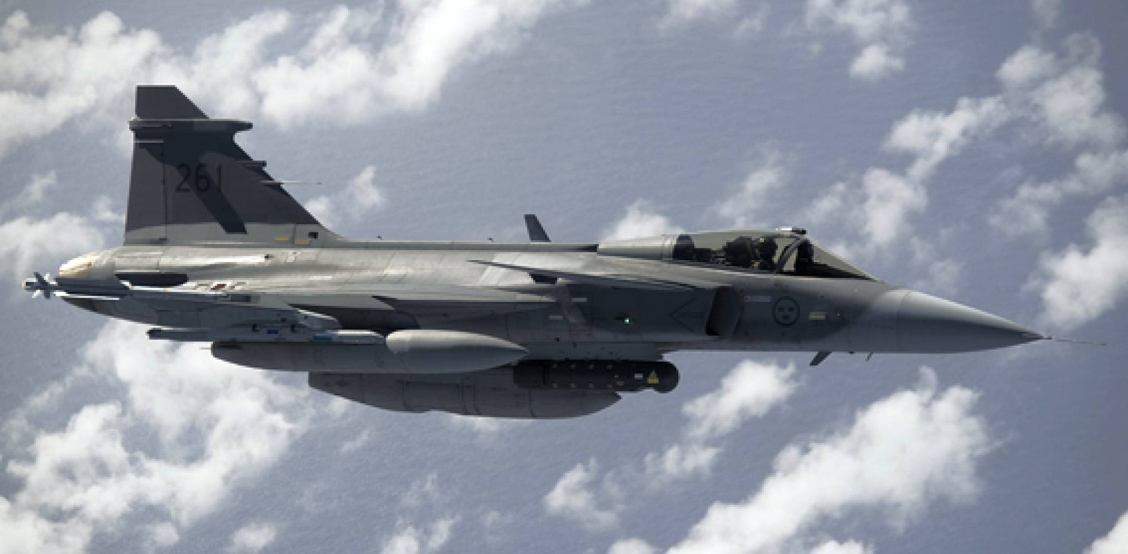 A Gripen refuels over the Mediterranean before heading to Libya. It carries a...