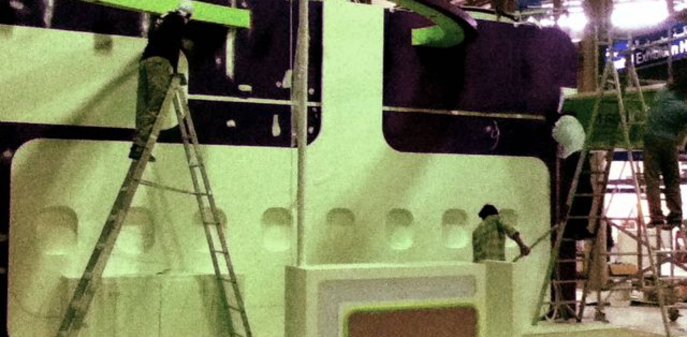 Workers set up the Moon Jet both at MEBA 2010....