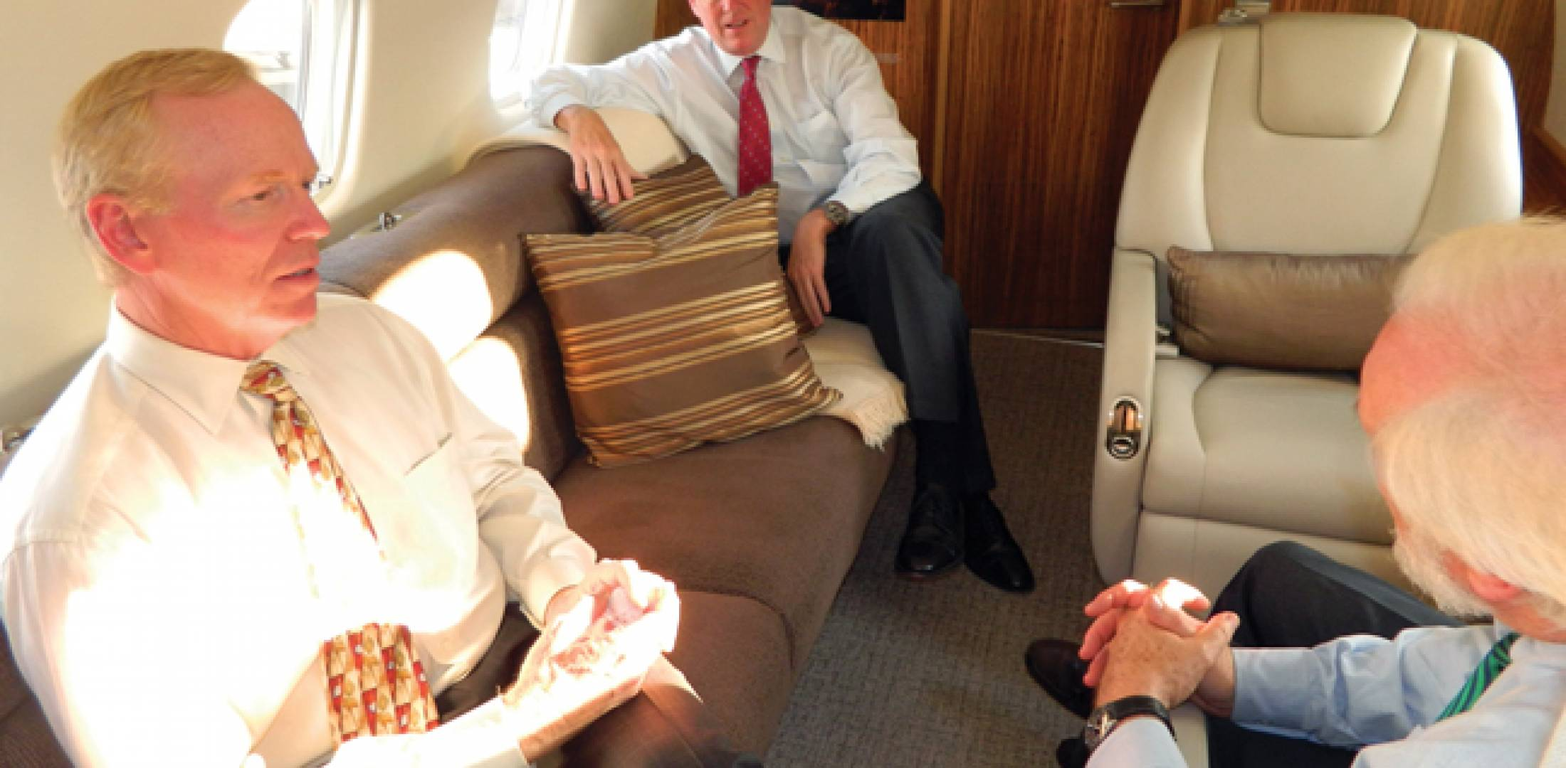 L-r: Embraer's Robert Knebel and Christian Kennedy chat with this magazine's editor aboard the Legacy 650 last month. (Photo: R. Randall Padfield)